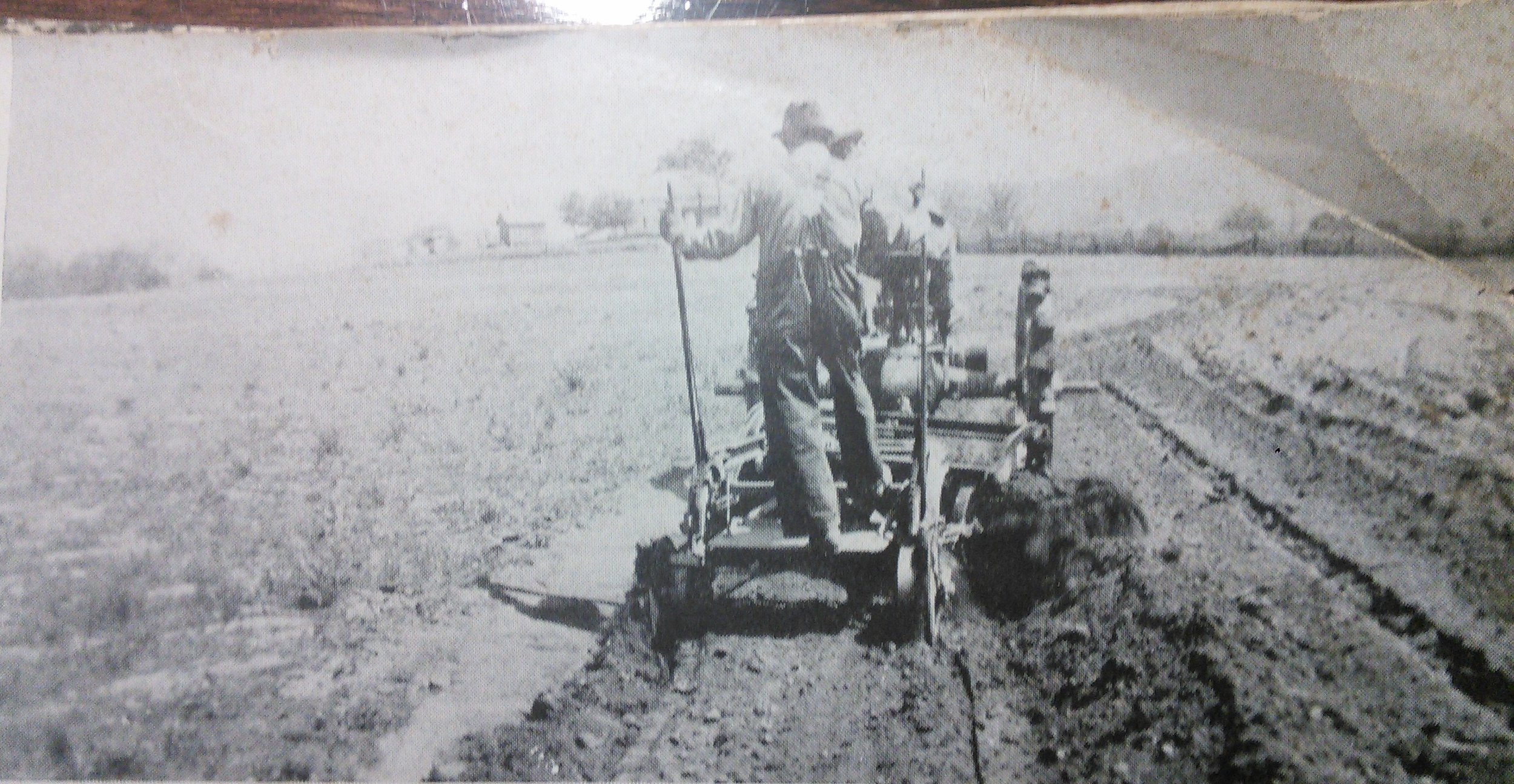 Overton County Farmer in 1940. Can anyone identify the implement he's using?  Please leave a comment if you recognize it. My best guess is a planter