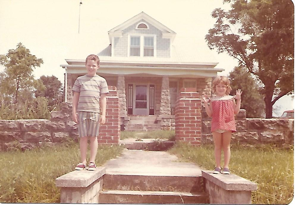 Shawna with her brother in front of the Lockhart House, home of her great-grandmother.