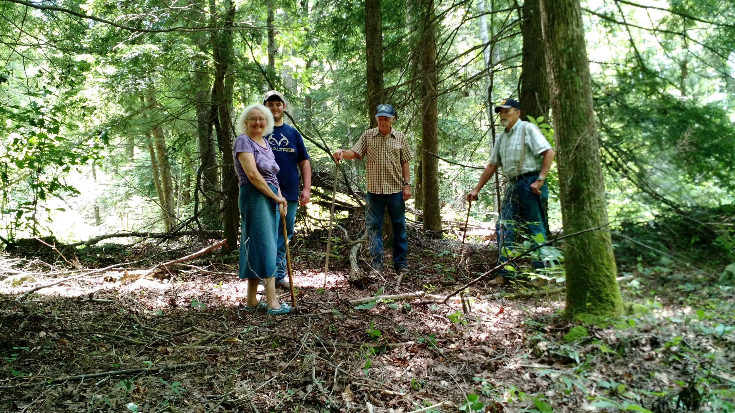 Freda Key Thompson (Great Granddaughter of Stephen Key), Logan Shaver, Darrell Stepp and Harlon Thompson stand in the clearing that remains where the house once stood.