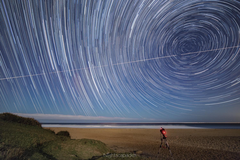 Moonlit beach and starlit sky