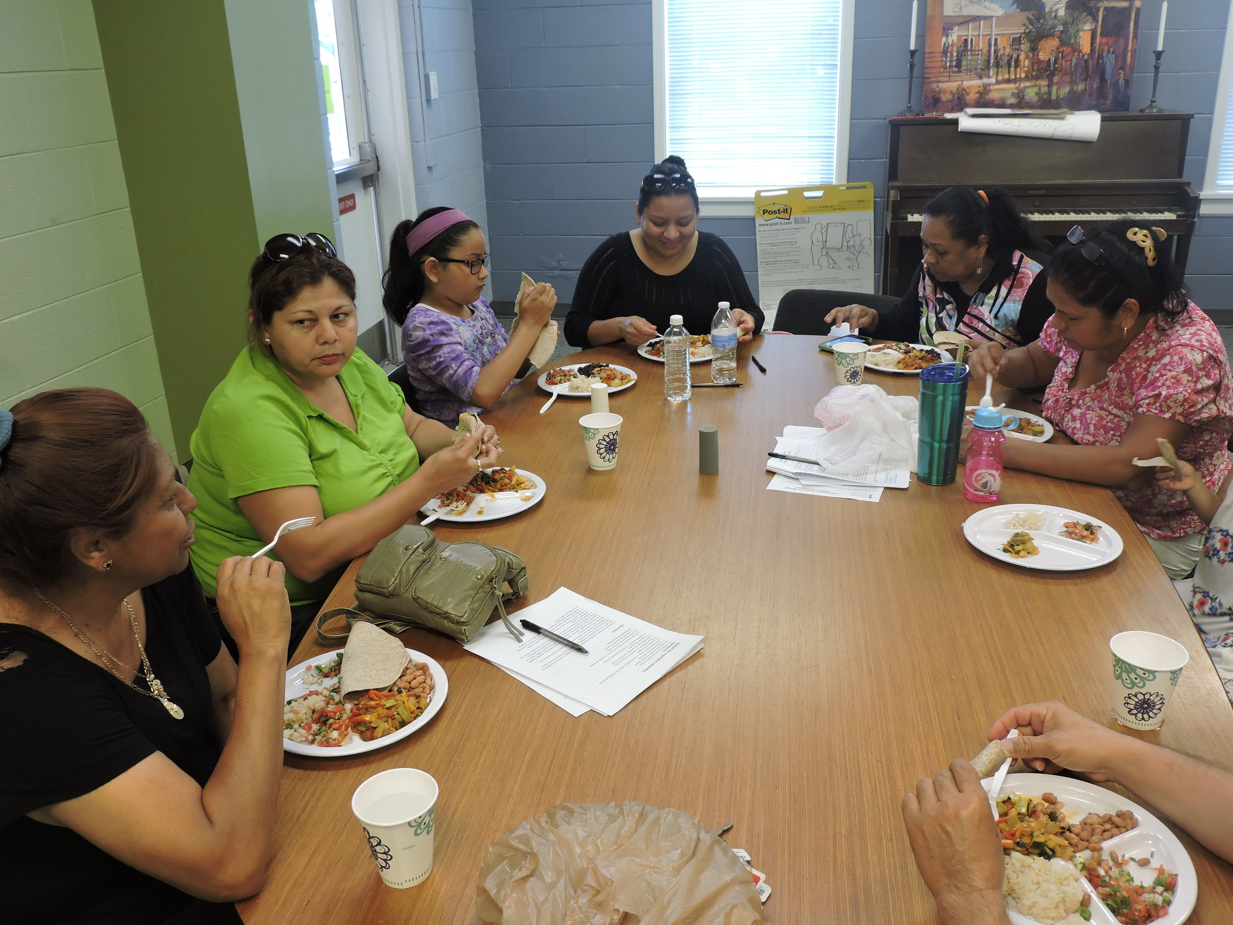 Alliance Medical Ministry patients socialize and enjoy the meal they prepared together.