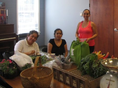 Zumba instuctor Paula Grabill and dancers grab some fresh veggies after a great workout!