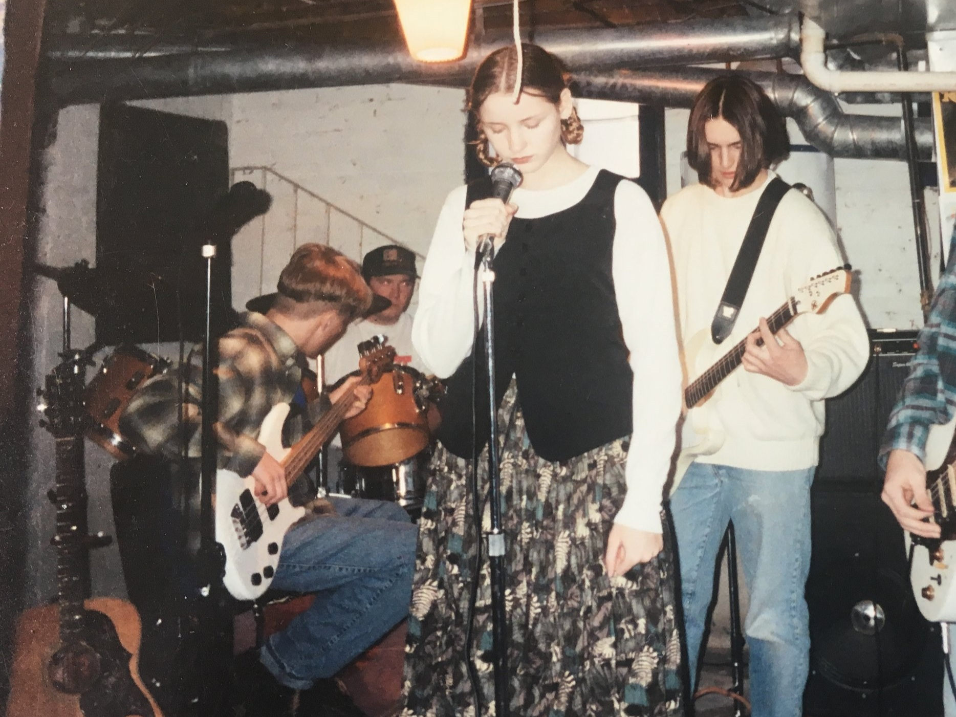 Dave and Kristine in David's parents' basement rehearsing, 1994.