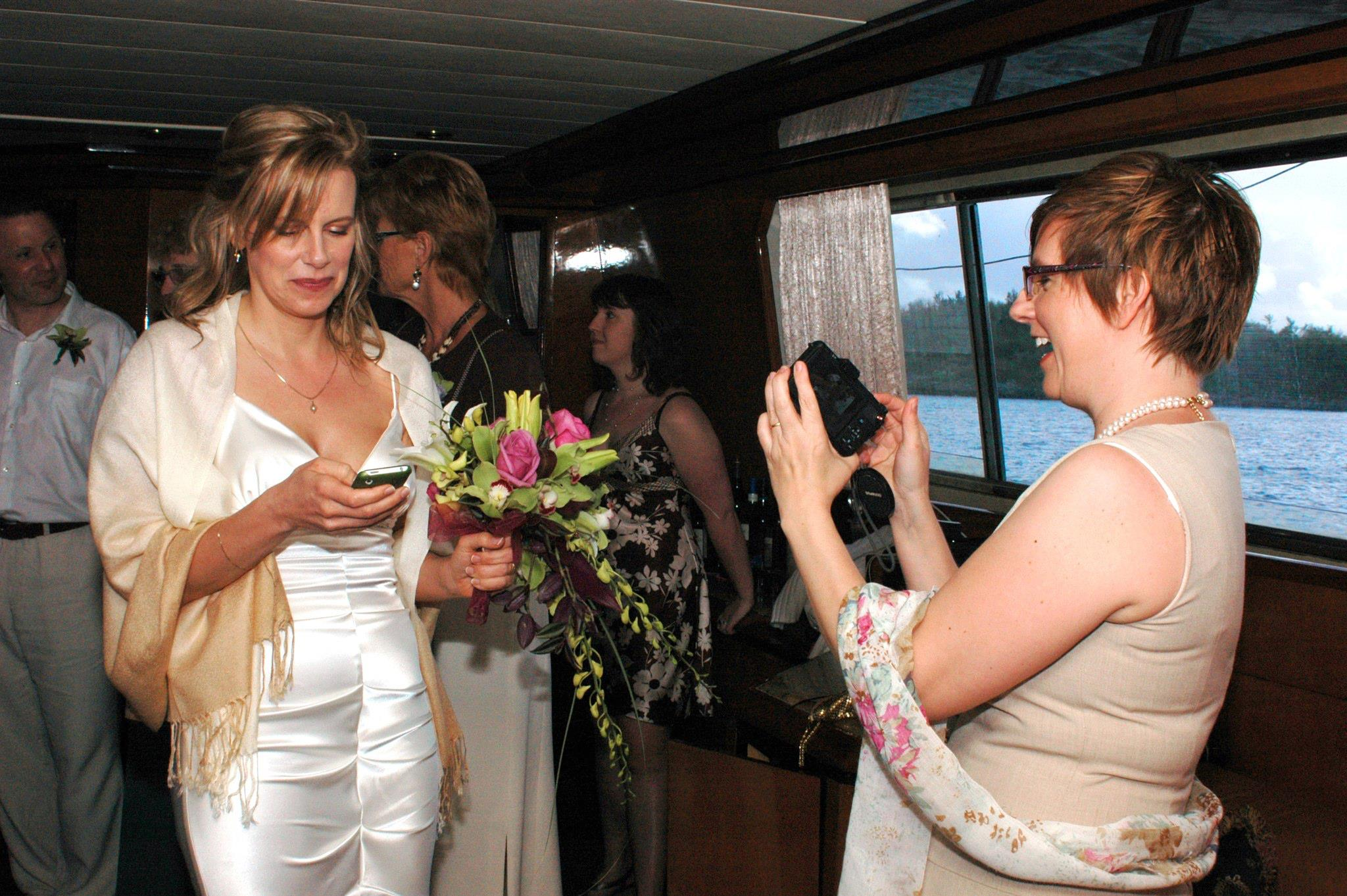 "This is me on my wedding day, tweeting ""I do."" Then I put the phone away—I swear."