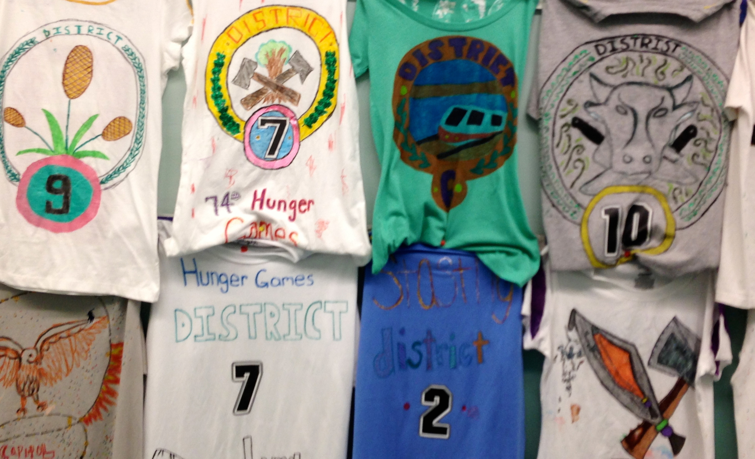 The Hunger Games   book reports-each student researched one of the districts from the  novel, proposed a logo based on the setting description and the role of  the particular district in their society, and designed created a promotional t-shirt.