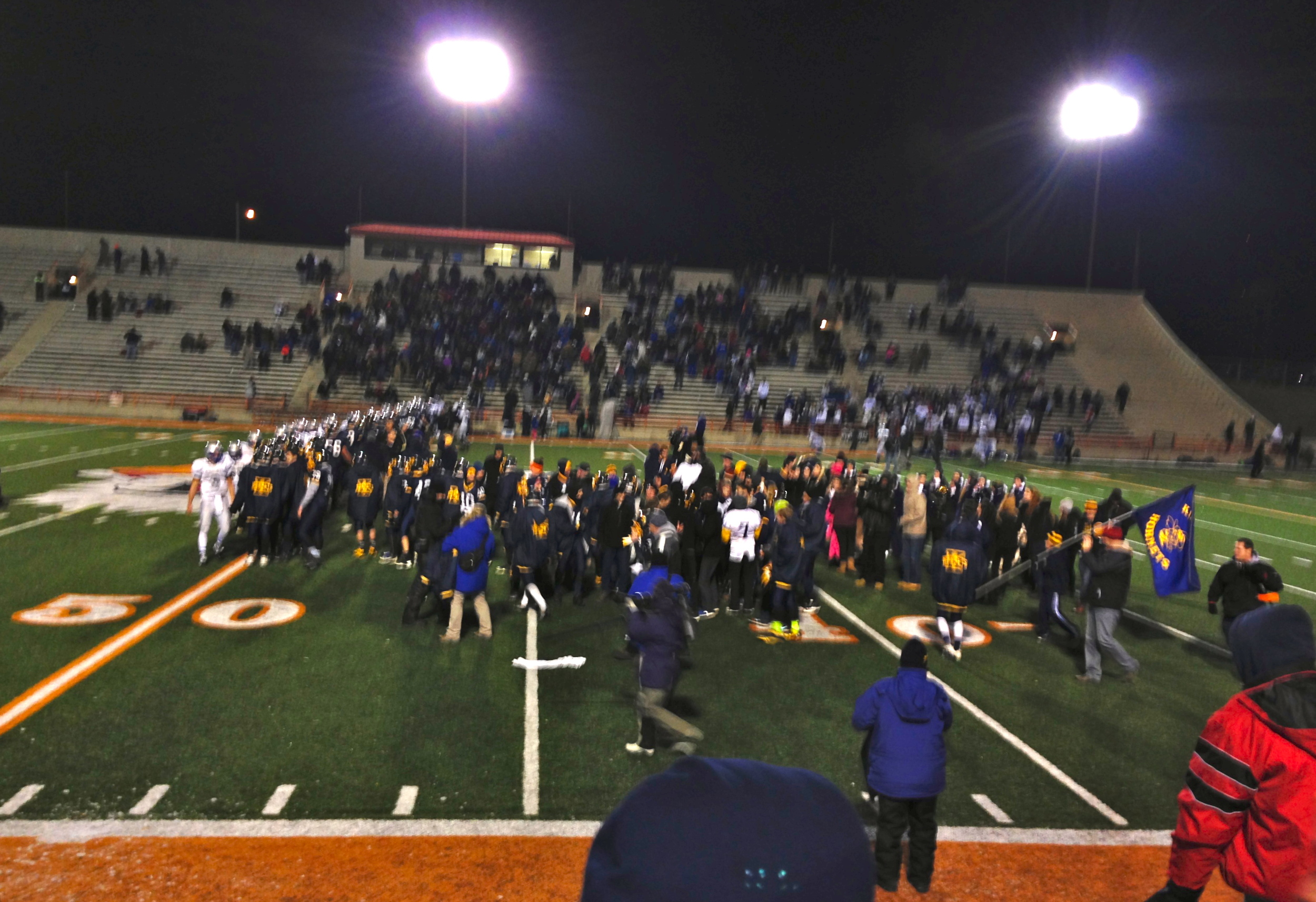 Kirtland family and friends run on to the field to congratulate their team on their win over Bishop Ready last night.