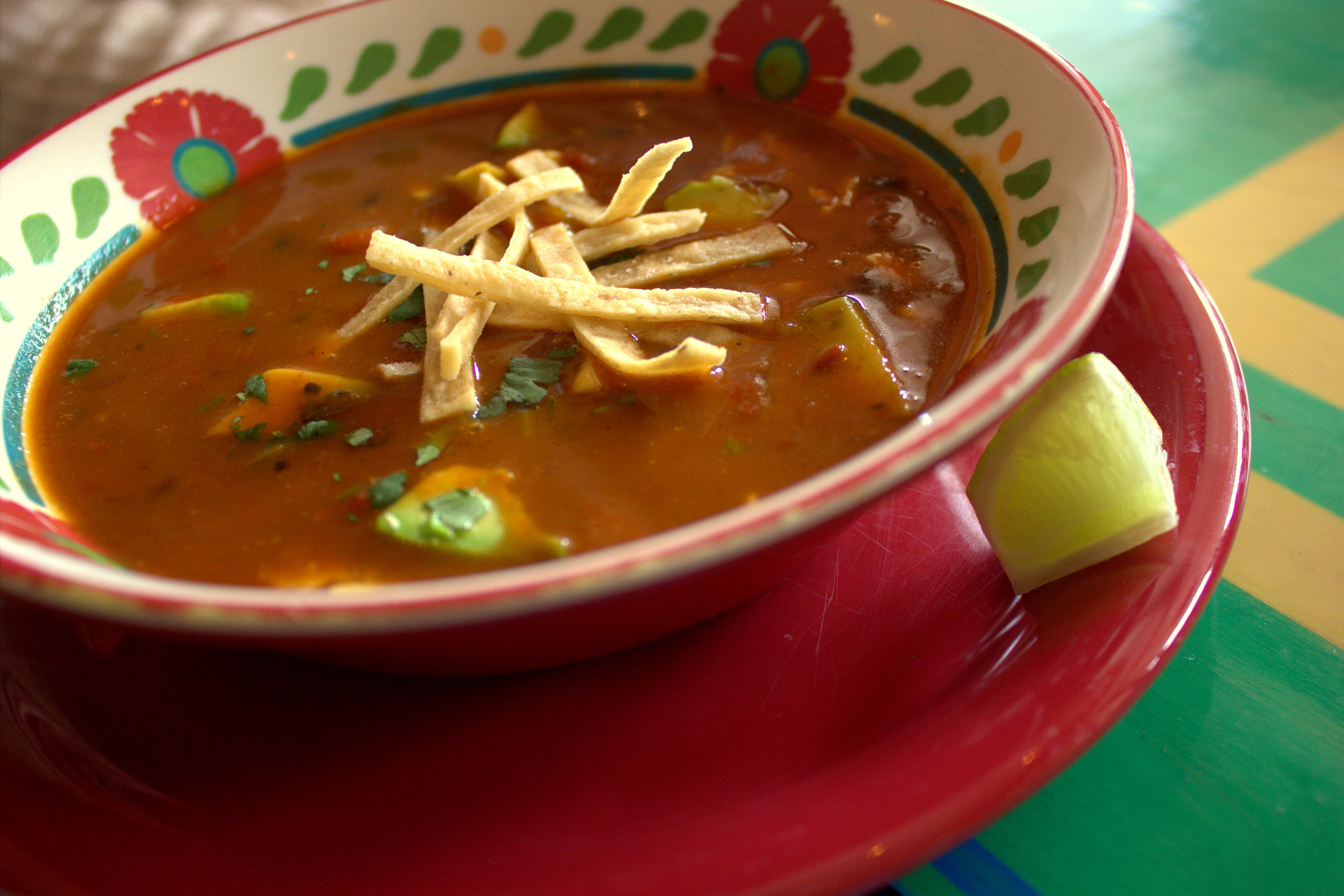 Tortilla soup, with fresh veggies and chunks of avocado