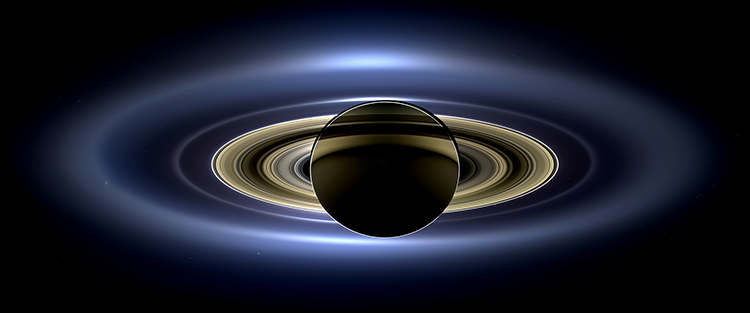 Saturn eclipses the sun.   This image is in the public domain because it was solely created by NASA.  It was obtained from Wikipedia Commons.   Here  is a link for more Cassini images.   Here  is a link for excellent info on Saturn including a breakdown of the rings.