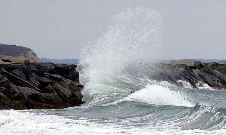 A nice picture of a wave.  Looking over the Old Harbor breakwater to Clay Head.
