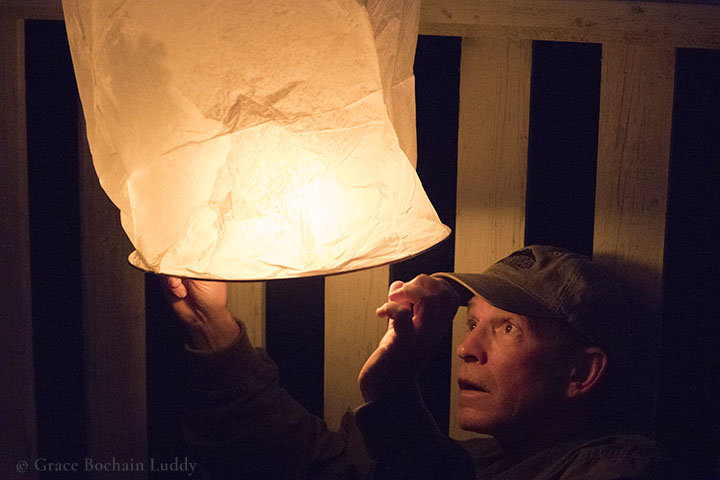 My brother George, up in Nova Scotia, lighting a Chinese Lantern.