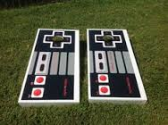 Cornhole boards painted to look like NES controllers.