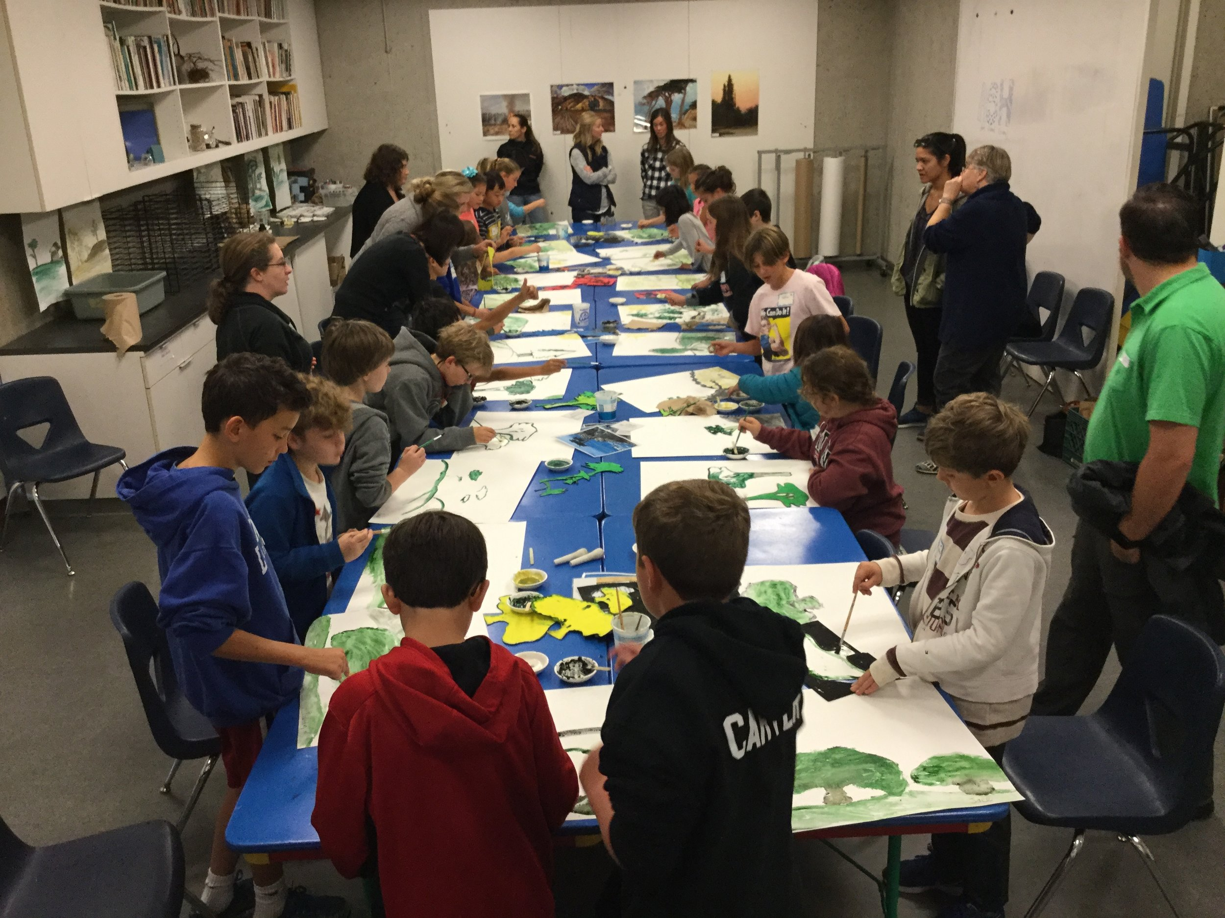 4th graders using their own paint in landscapes.JPG