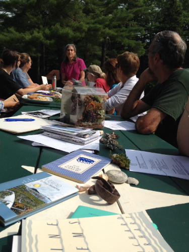 Poet Judy Steinbergh leading participants through readings of nature poetry before they set off to write there own.