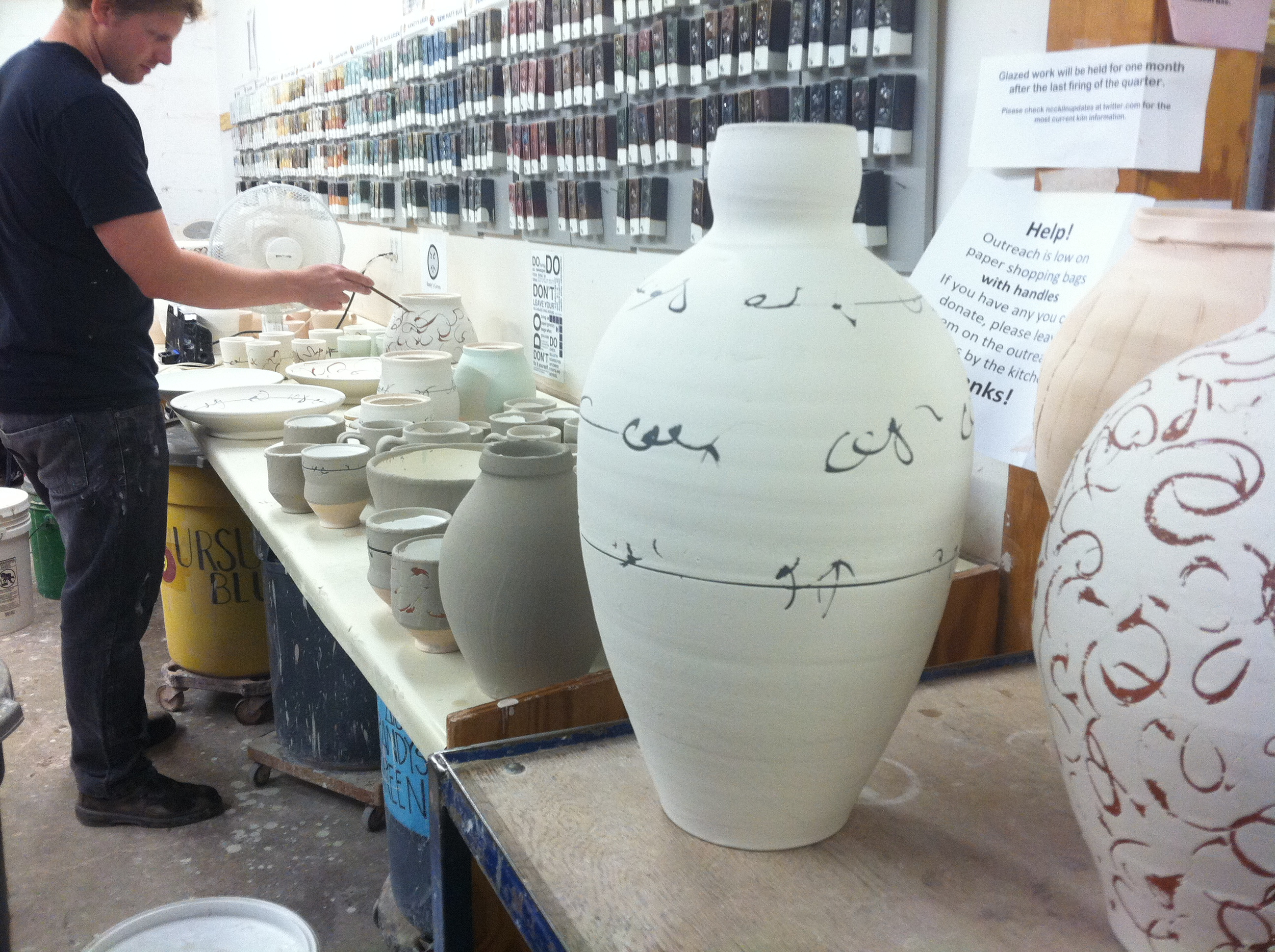 Pots being glazed.