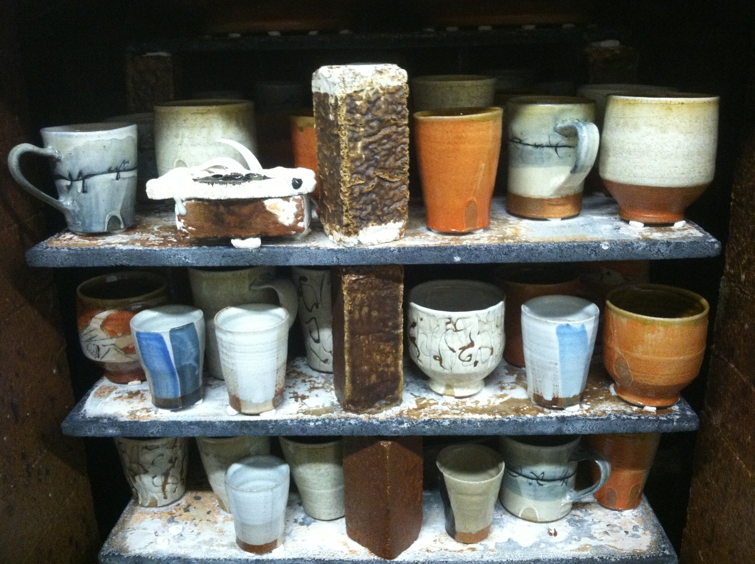 Fired pots in the kiln.
