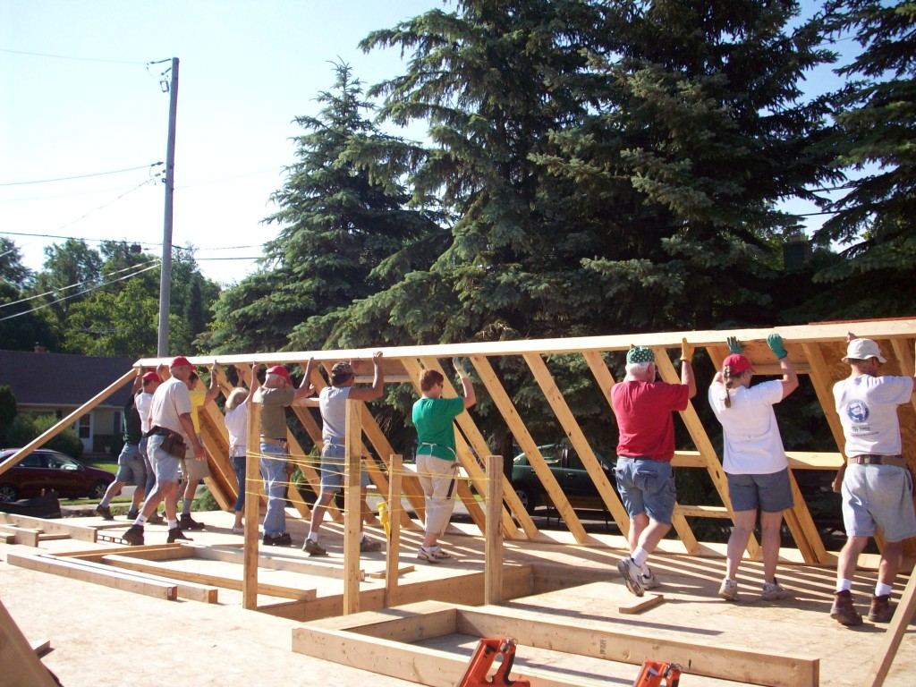 Volunteers with Greater Fox Cities Area Habitat for Humanity construct a house for low-income residents in their Wisconsin community. PIMG has worked with Habitat and its partner, Rebuilding Together, to develop a strategic alliance around low-income housing.
