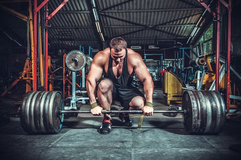 powerlifter-with-strong-arms-lifting-weights-royalty-free-image-595768514-1546267269.jpg