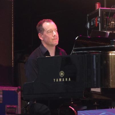 CB plays piano at BGS Trafalgar Square.jpg