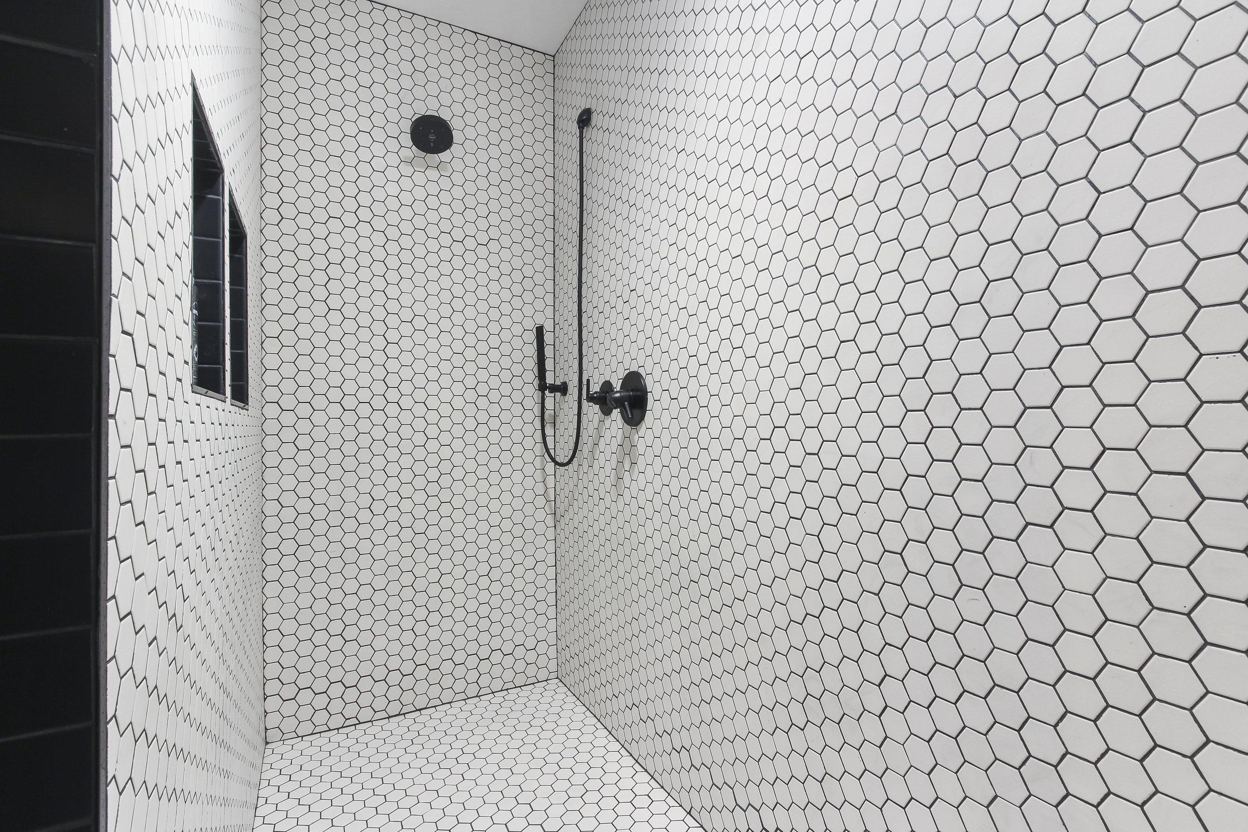 White Hexagon Tile Shower Design.jpg