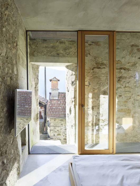 543dd5f0c07a802a69000258_stone-house-transformation-in-scaiano-wespi-de-meuron-romeo-architects_1430_cf030772-530x707.jpg