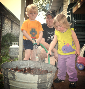 Chef Justin getting help from Benjamin and Violet for a crawfish biol