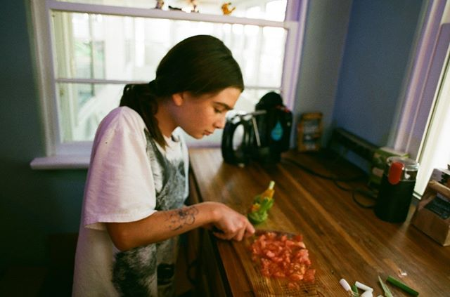 Chef-in-training.  #35mmfilm #cooking #parenting #superiaxtra400 #analogphotography