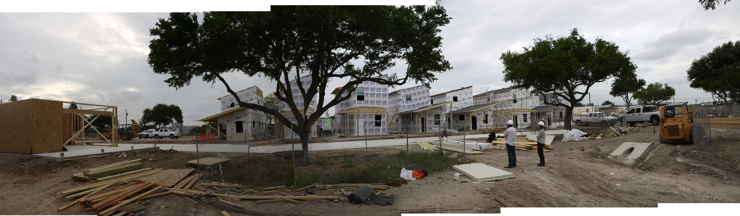 First community building under construction on the left.