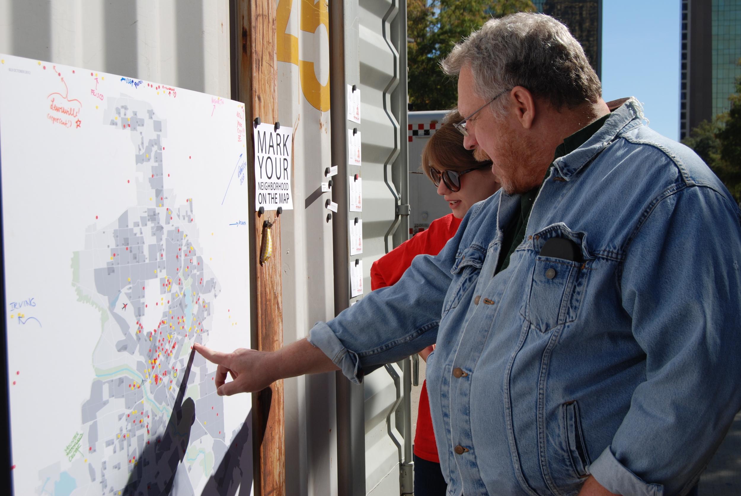 A visitor explains Buckner Terrace's historic boundaries on the City Map