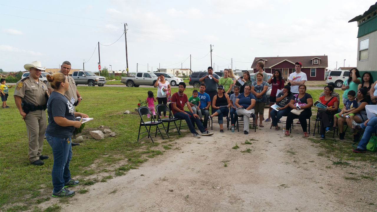 A Lucha trained leader engages a local neighborhood around Colonia issues.