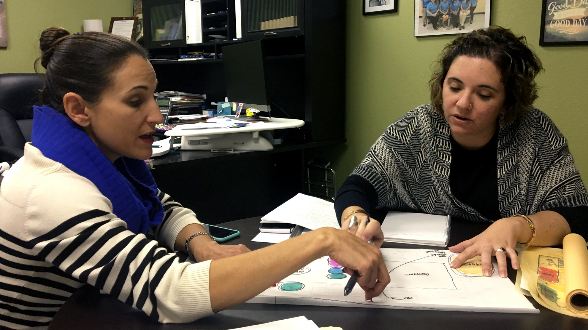 Rebecca of the Hope Family Health Center and Carolina of ORANGE-MADE discuss schematic design ideas for HFHC's new facilities. The project is currently in the implementation phase and expected to be completed in the spring of 2017.