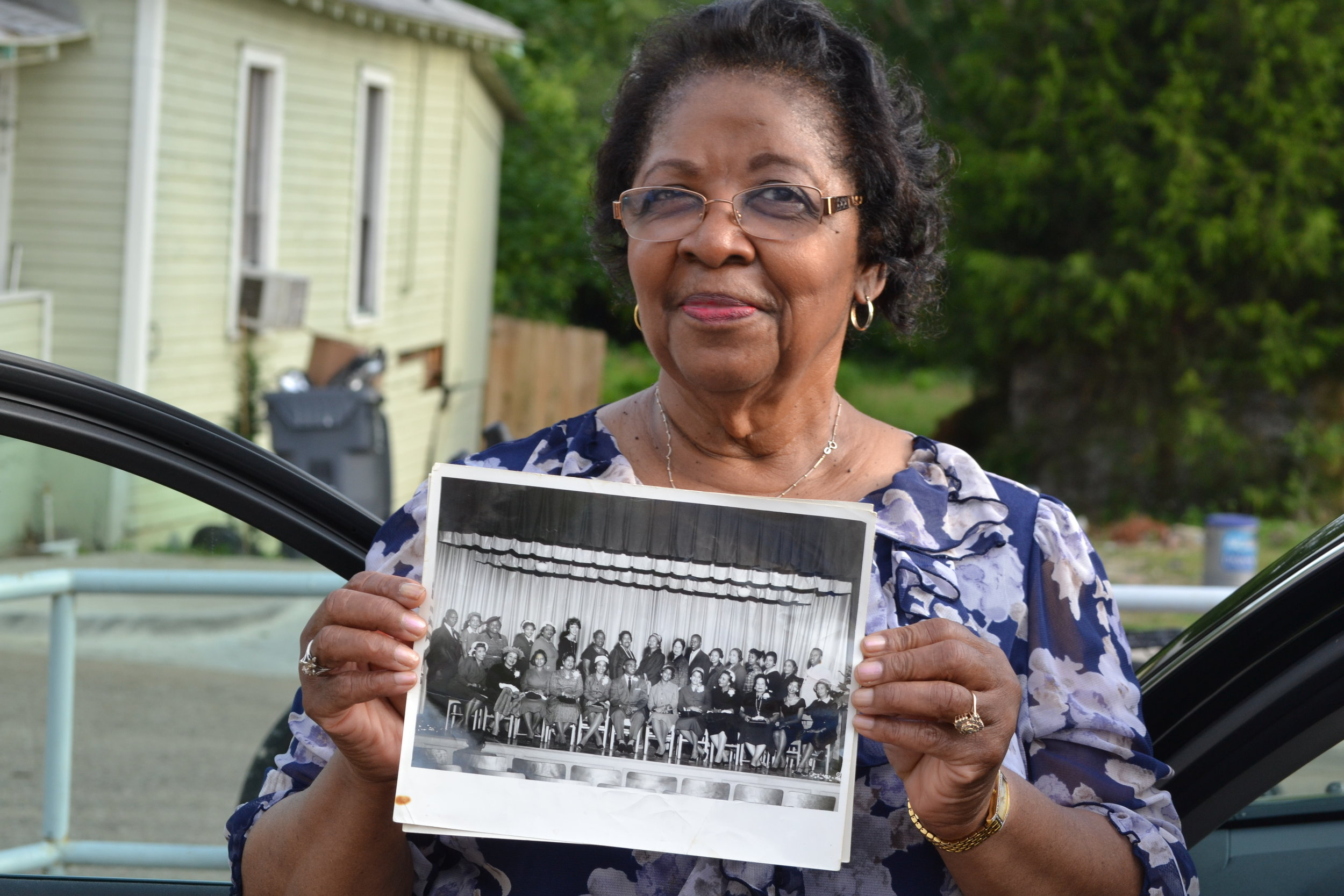 A resident displays a historic photograph.