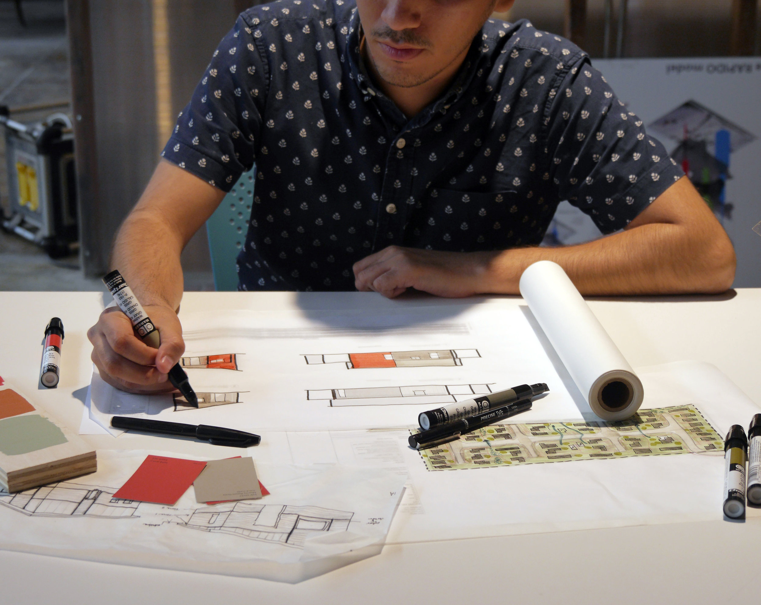 Design Associate Luis Murillo works on Casitas Azucar in [bc]'s Brownsville office