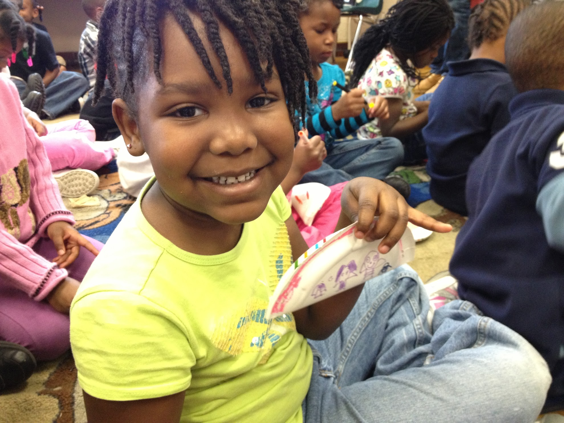 Making paper music shakers with elementary school students to encourage creative reuse of household object.
