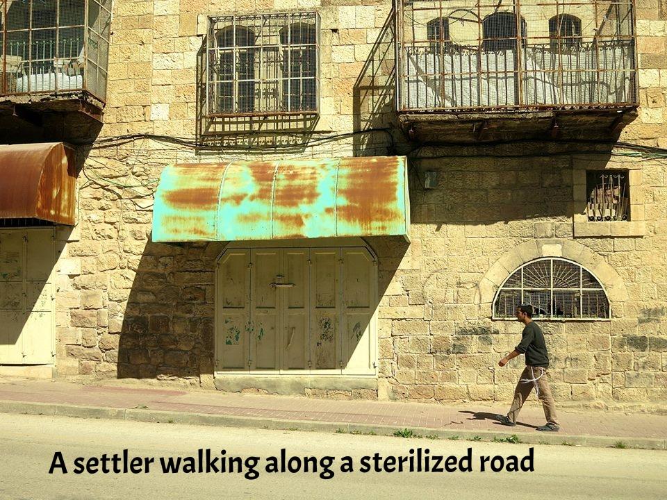 A settler walking along a sterilized road.jpg