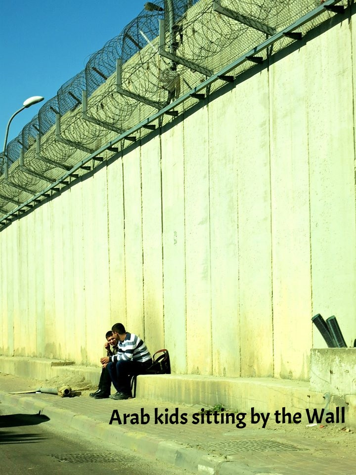 Arab kids sitting by the Wall.jpg