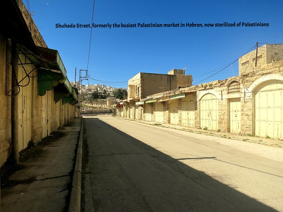 Shuhada Street, formerly the busiest Palestinian market in Hebron, now sterilized of Palestinians.jpg