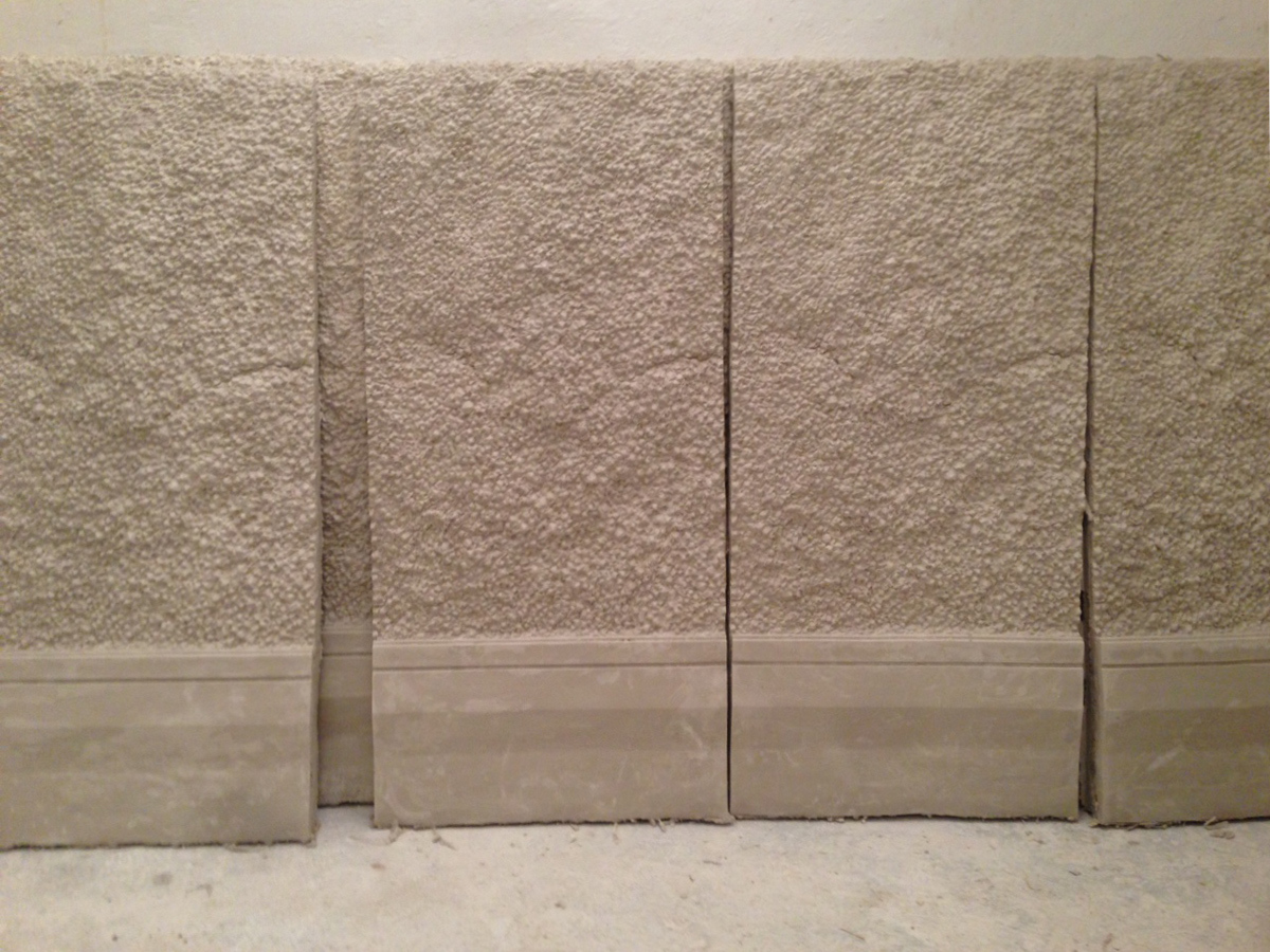 Process photo of handmade plaster panels used for room installation while in making