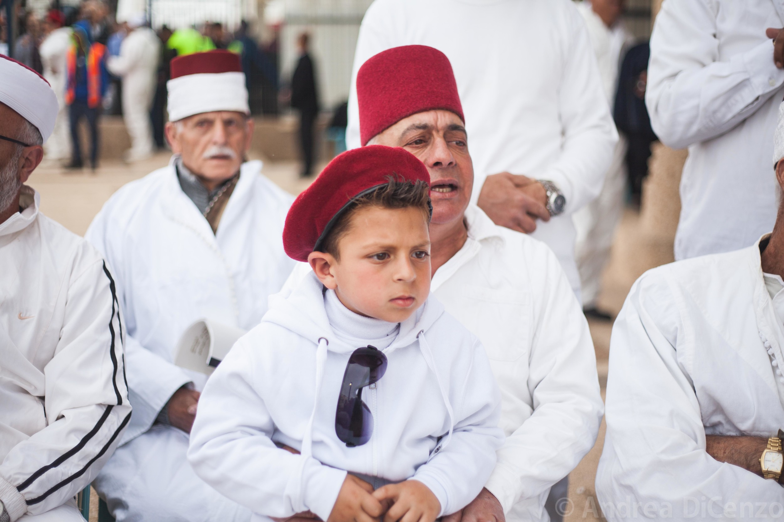 Men chant and wait for their communitiesannual sacrifice to beginonMount Gerizim.Thisancient community of Samaritans is one of the oldest religions in the world consisting of roughly seven hundred people today.