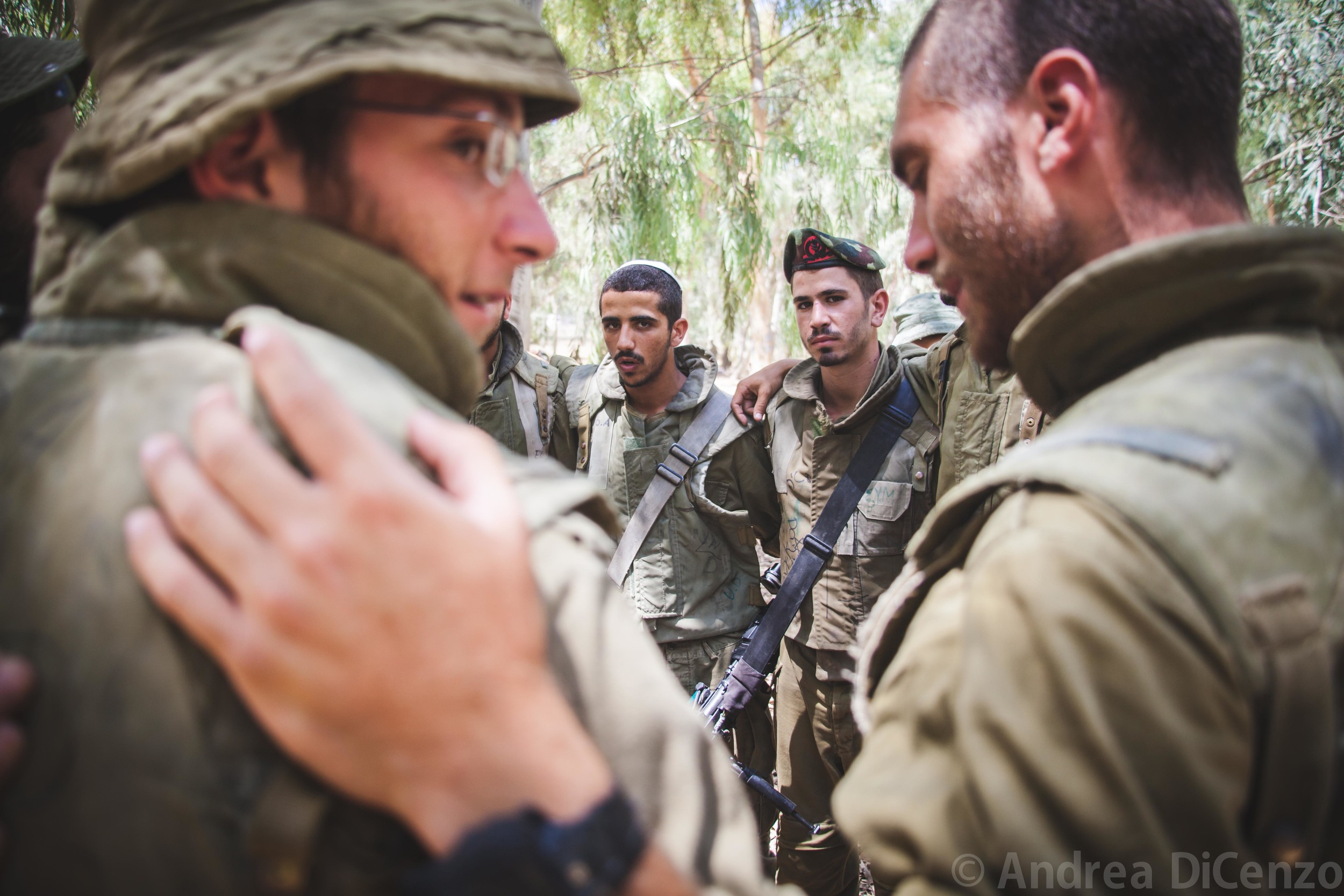 IDF soldiers chant songs and prayers as they await further instructions along the border of Gaza. These men are part of an additional 18,000 soldiers that have been called up to the border as part of Operation Protective Edge.