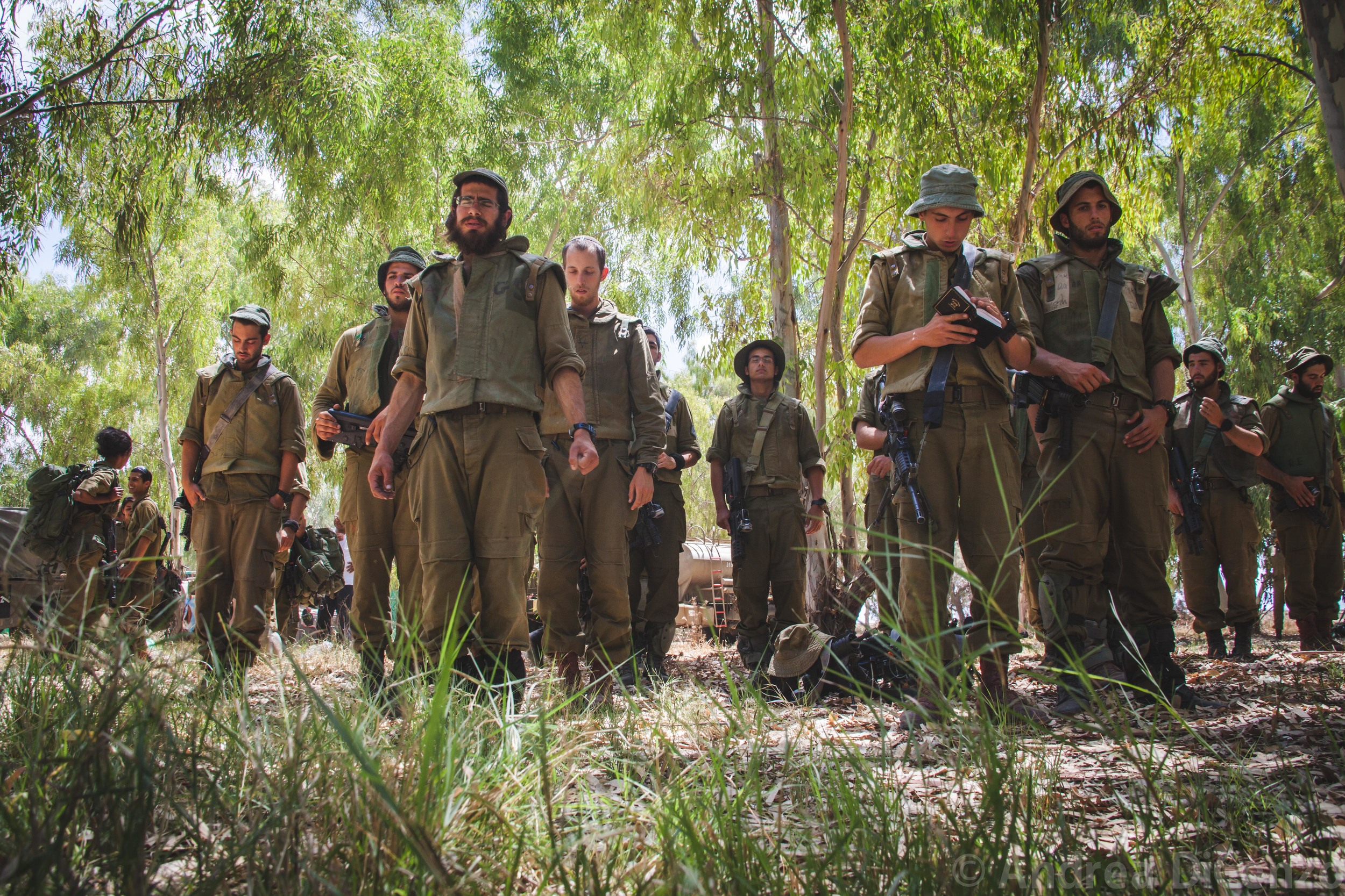 Israeli soldiers pray before their deployment into Gaza during Operation Protective Edge.