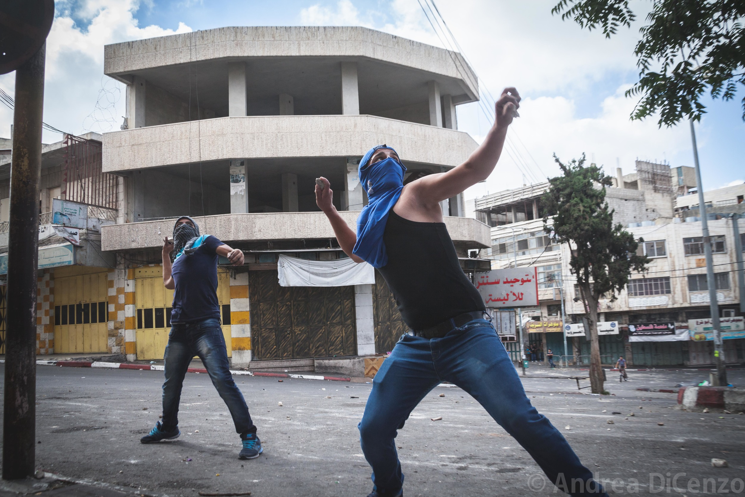 Young men throw rocks at the Israeli Defense Forces in a violent clash in Hebron, West Bank.