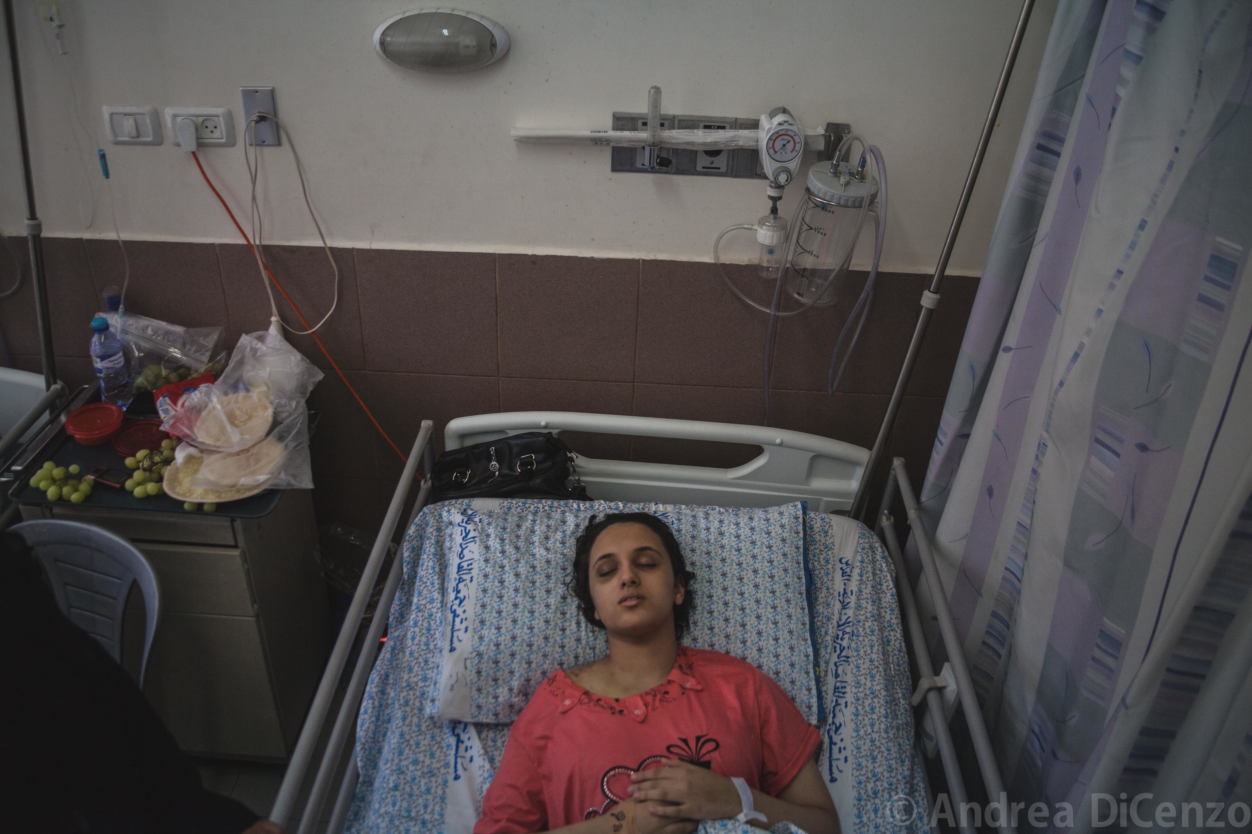 Ahad, 14, is coming out of a coma in Al-MaKassed Hospital in East Jerusalem. She is unaware that her parents didn't survive the attack.