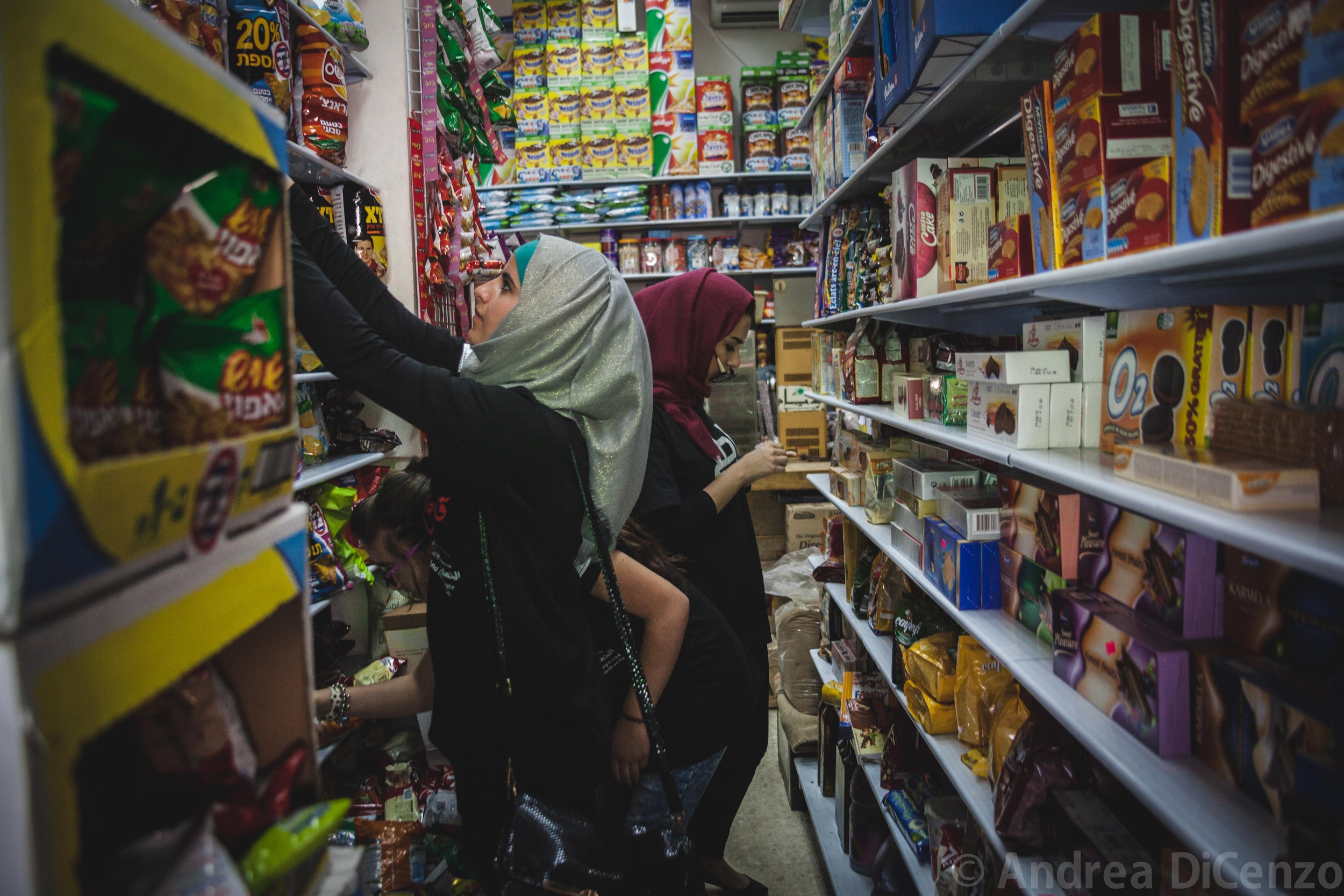 Palestinian women put stickers on Israeli products in Bethlehem, West Bank as part of the Palestinian boycott movement.