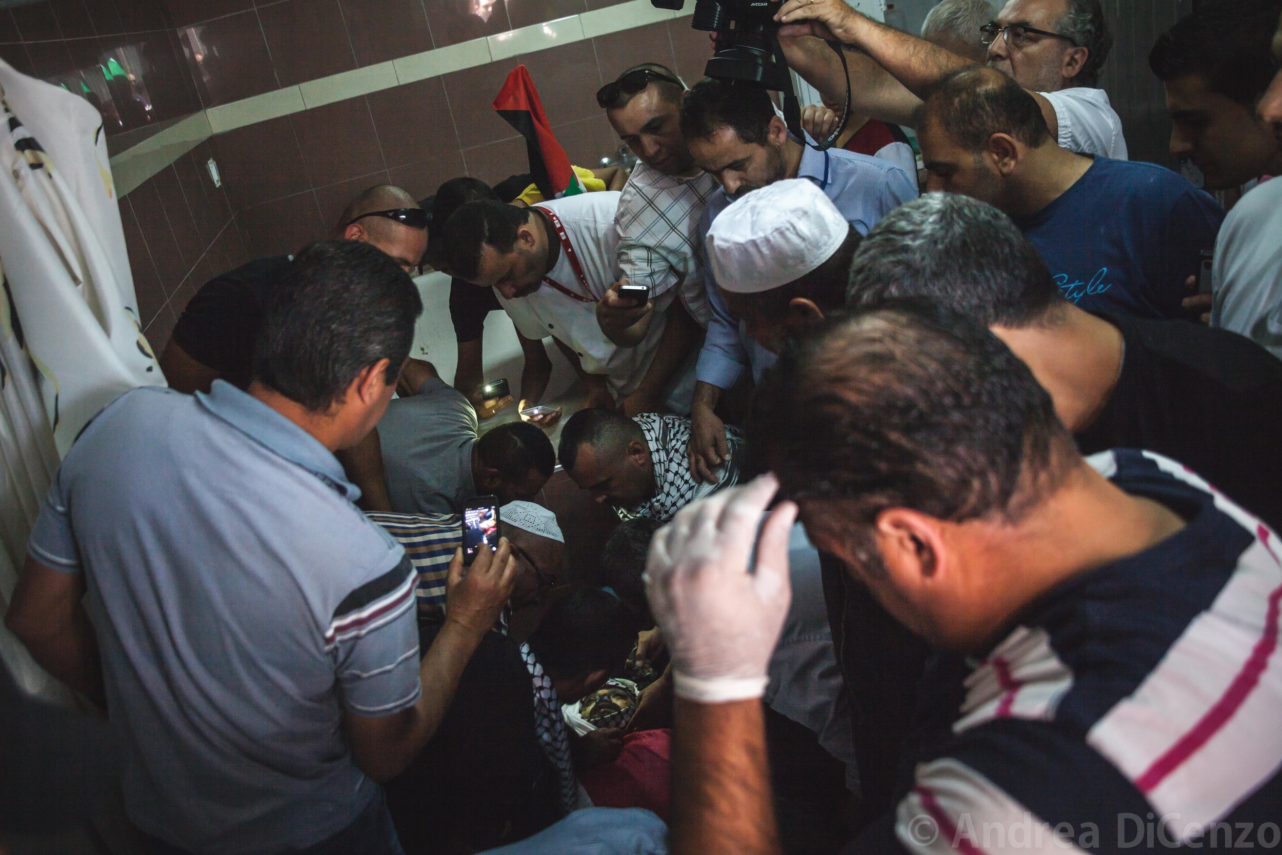 Mohammad is prepared for his funeral precession in Al MaKassed Hospital, East Jerusalem before his body is transported back to Gaza for burial. The Gazan came in at 3am but did not make it through the night.