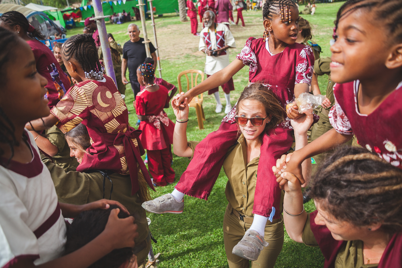 Israeli soldiers play with children of the day of New Passover - a holiday celebrated by the Black Hebrew Israelites of Dimona, a small minority group which is based in the center of the Negev Desert. The community is mainly made up of groups of African Americans who believe they are descendants of the ancient Israelites.