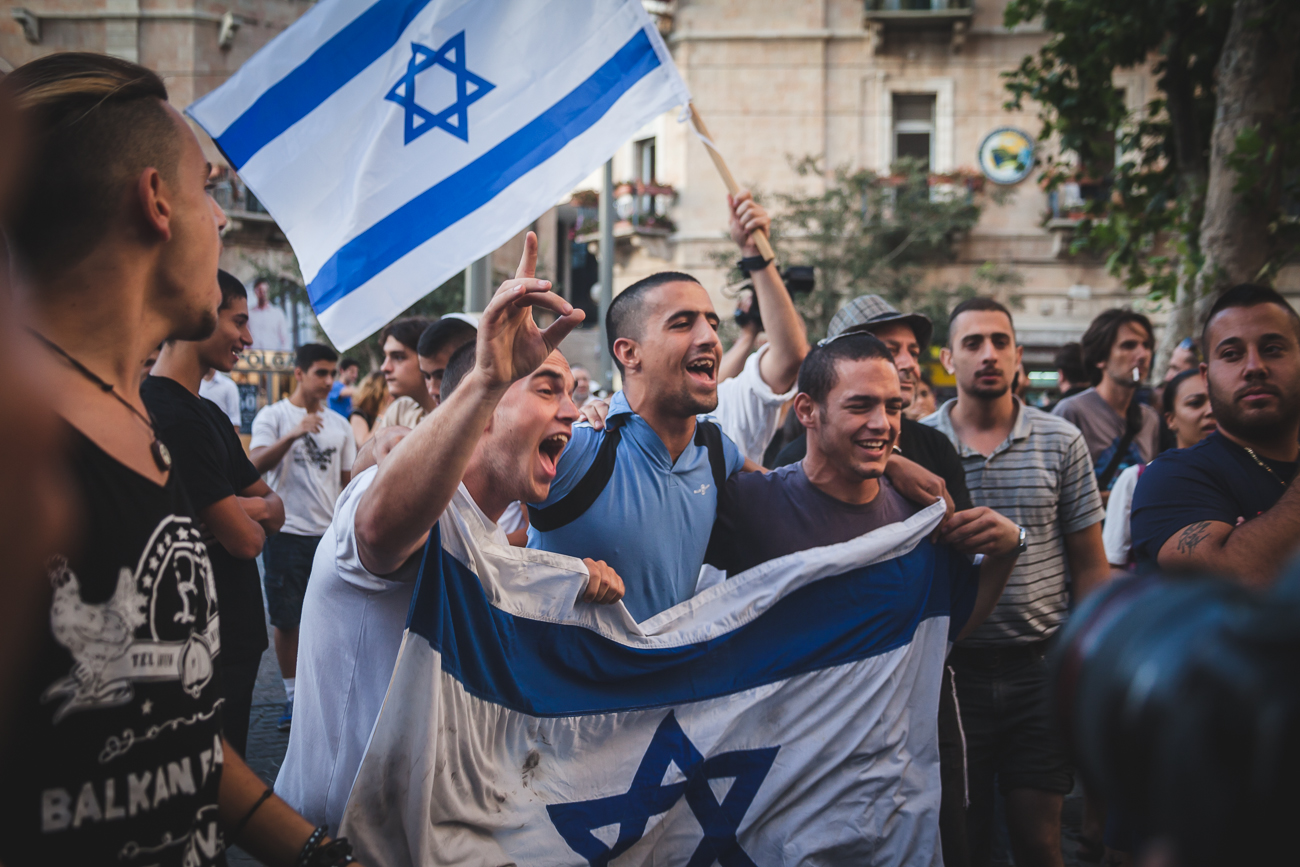 Extreme right protestors yell chants and sing song over peace-protestors in Jerusalem's Zion Square. Since the boy's went missing in the beginning of June, these right wing protestors have taken to the streets weekly to spread their message, as well as target and harass Arab citizens. One of their chants is 'Death to Arabs'. Police and peace activists show up in equal numbers to abate the situation.