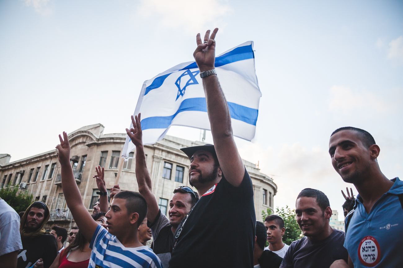 Right-wing protestors taunt peace activists at a rally inZion Square, Jerusalem,during Operation Protective Edge. Right-wing protestors take to the streets weekly to hand out leaflets highlighting their objectives and harassing Arab citizens and workers.