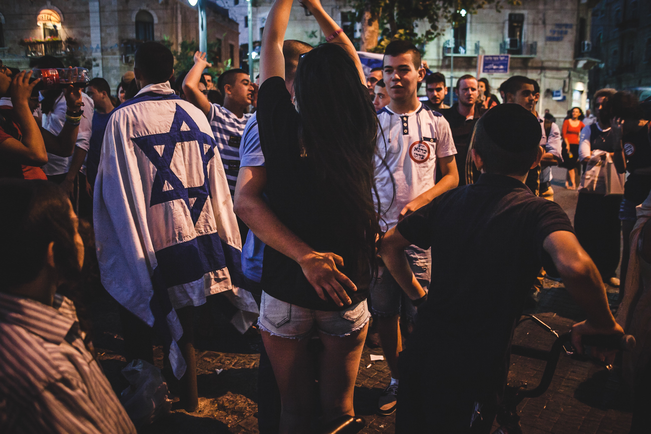 A couple embraceduring a extreme right protest in Jerusalem. The protest didn't have a license and the police were present to make sure the demonstration was contained.