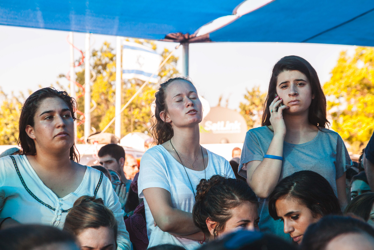 Three girls mourn for the death of their fellow countrymen at the state funeral of Naftali Fraenkel, Yaakov Naftali, and Eyal Yifrah.