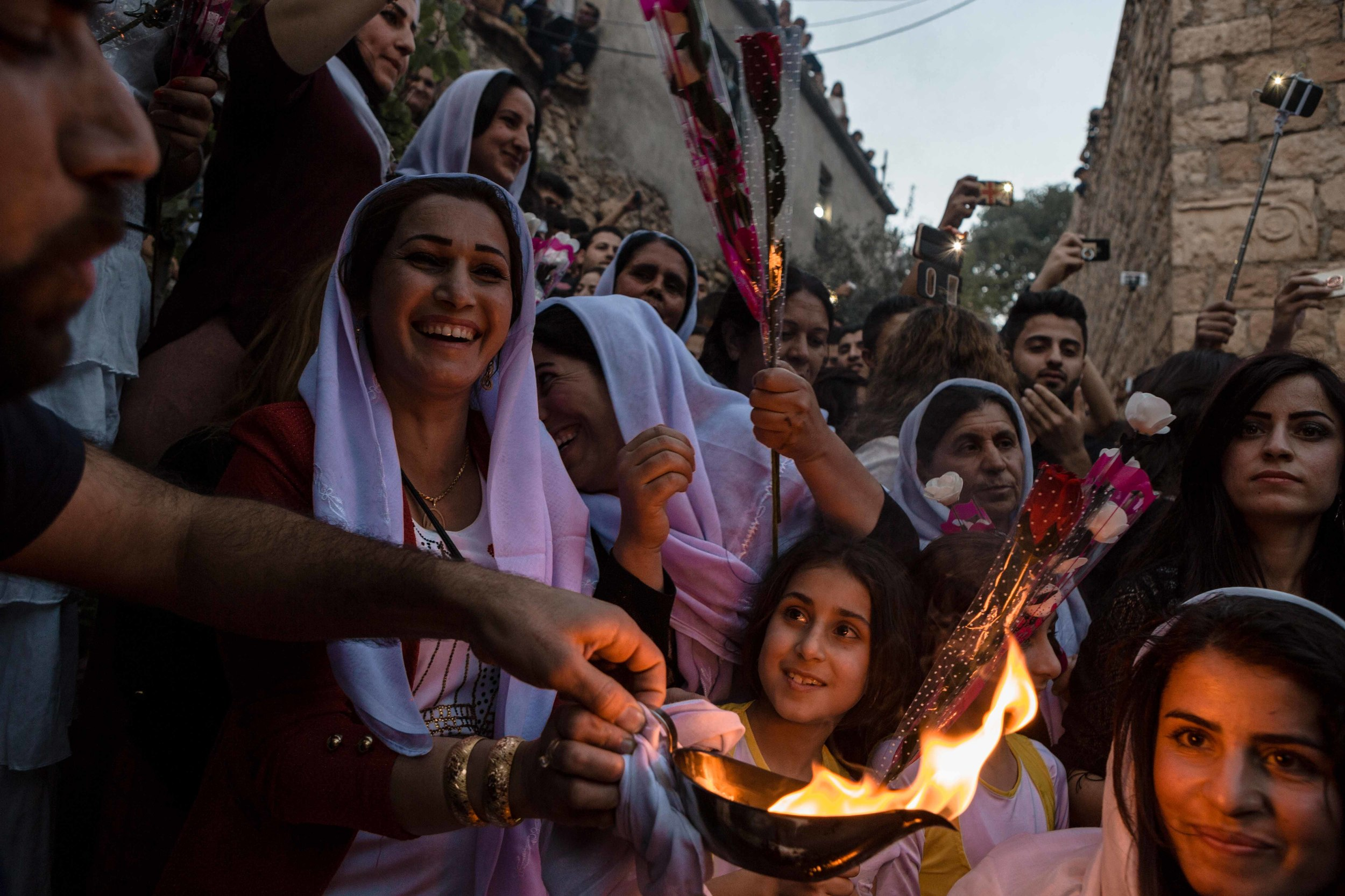 Thousands of Yazidis gather at the religions holy temple of Lalish for the lighting of the candle celebration for Yazidi new year.